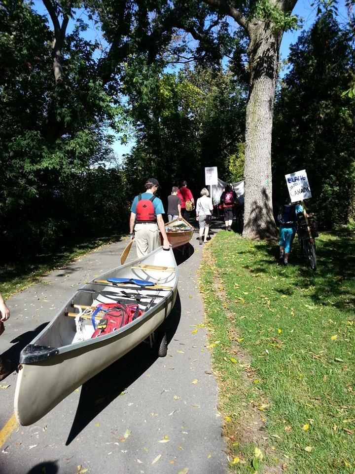 Canoes out of the water for final push to rally at City Hall. Communities standing up to the proposed TransCanads tar sands export pipeline through Ottawa.