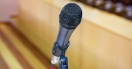 microphone at the podium to speak at the conference hall